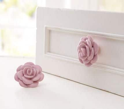You can add touches of pink to the nursery using small fixtures like these dresser knobs