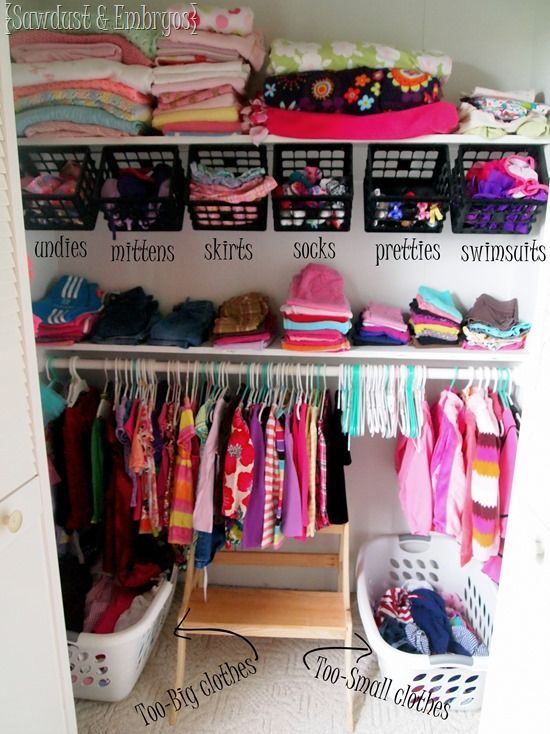 This nursery storage idea has everything you need to organize your closet using shelves, baskets, a rod for hanging your clothes, a place to put the dirty laundry and a little floor space. To have each area labeled for what goes in that spot is also a great idea to help keep everything neat and tidy
