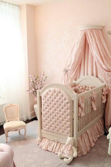 This soft pink Victorian nursery design is as girly as it gets! The fluffy accessories and beautiful fabrics are so inviting.