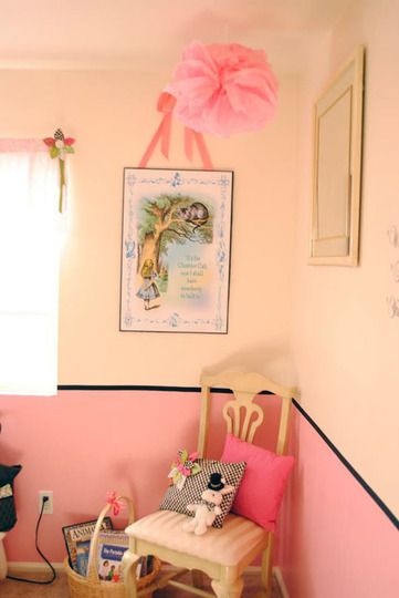 This nursery décor incorporates many shades of pink while remaining chic and not overly childish