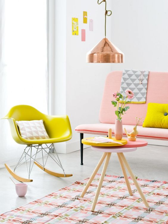 The décor in this pink nursery adds touches of industrial design to keep it looking sophisticated and unique
