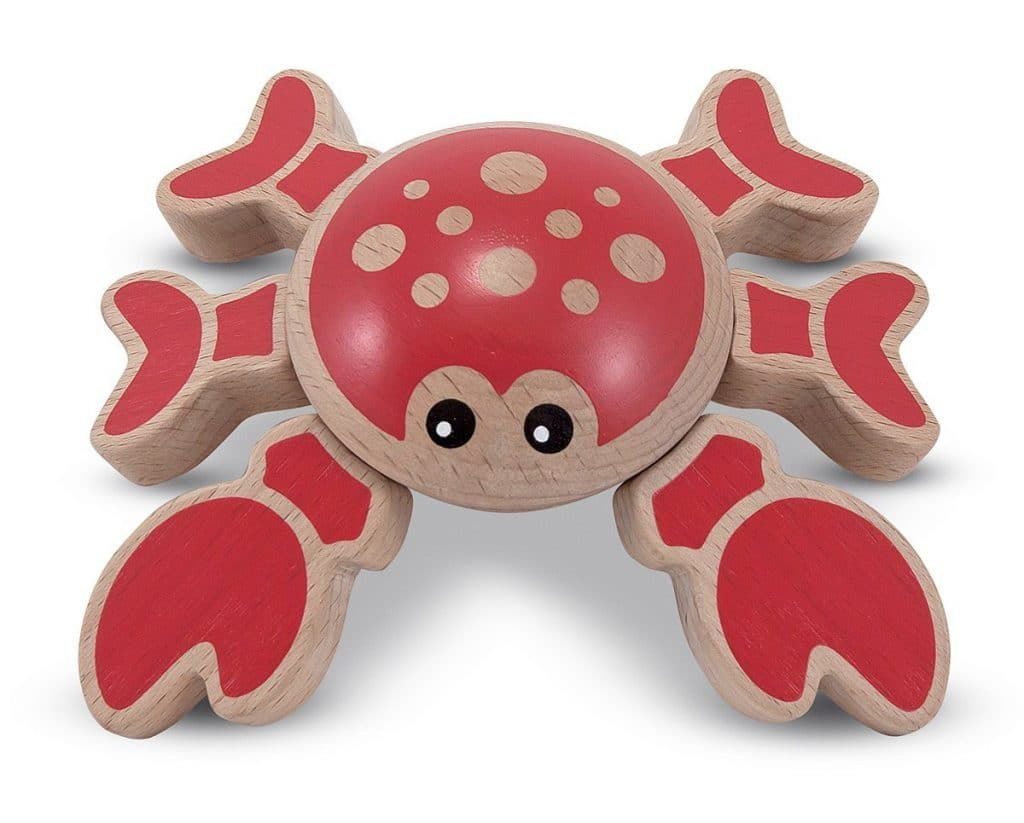 Crab wooden grasping toy. 6 legs attached to the body with elastic cords so that your child can spin and pose them, or push it down and watch it spring back up